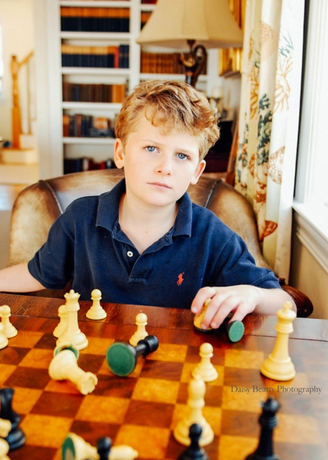 boy playing chess in fairfield ct by daisy beatty