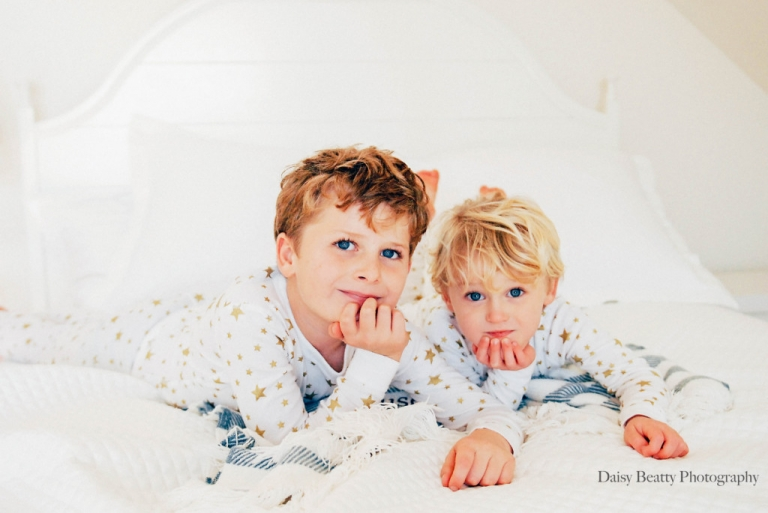 portrait of blue eyed boys in a beach house in rowayton ct by daisy beatty photography