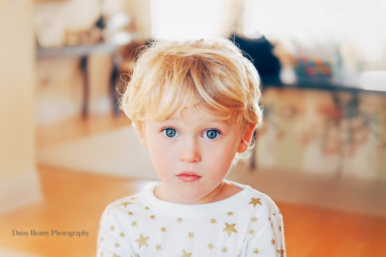 portrait of blue eyed boy in nyc by daisy beatty