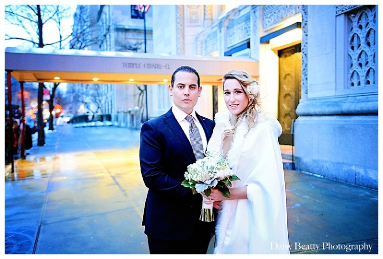 newlyweds outside of temple emanu-el in nyc by daisy beatty