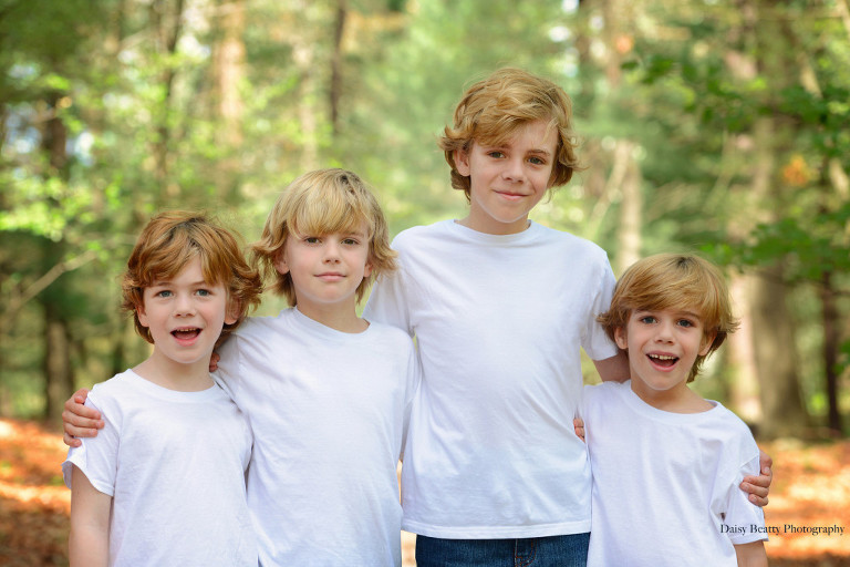 portrait of four brothers in the woods in greenwich ct