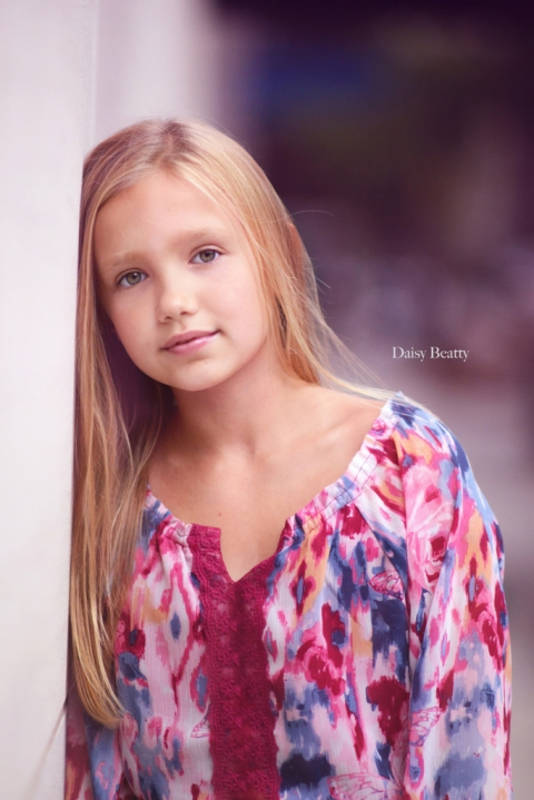 headshot of a professional child model in nyc by daisy beatty photography