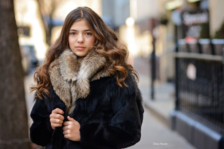 portrait of a girl in a fur coat on the upper east side of manhattan, by daisy beatty photography