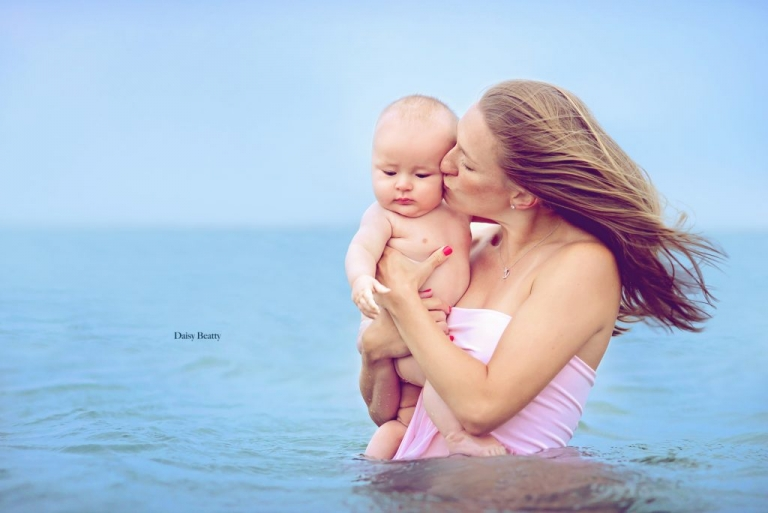 portrait of a mother and baby in the water in east hampton by nyc family photographer daisy beatty
