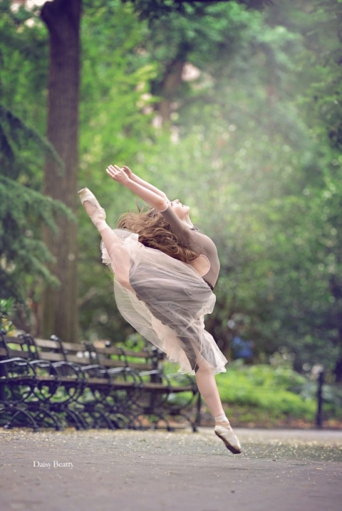 ballerina dancing in washington square park by New York ballet photographer daisy beatty