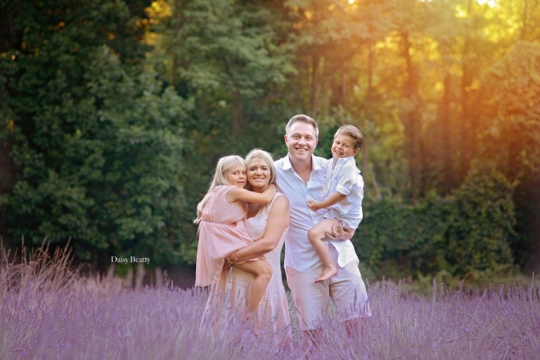 a family in a lavendar field at sunset by daisy beatty photography