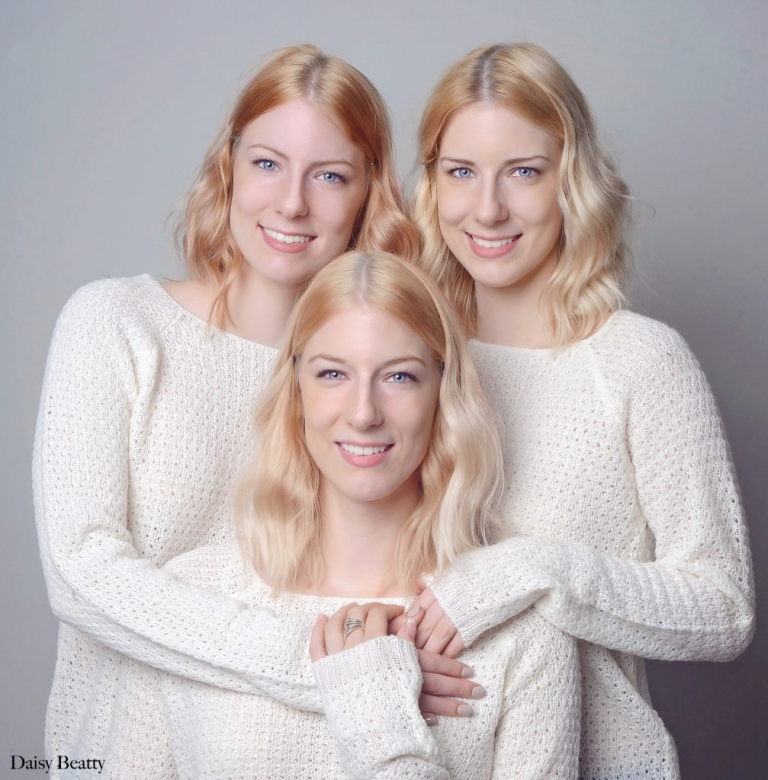 identical triples photographed in a family portrait studio nyc by Daisy Beatty
