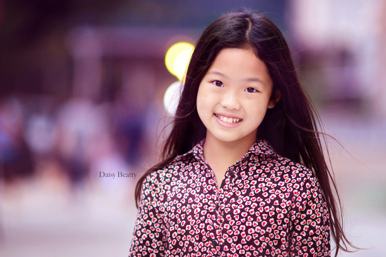 headshot by daisy beatty photography of a child model wearing h&m in NYC