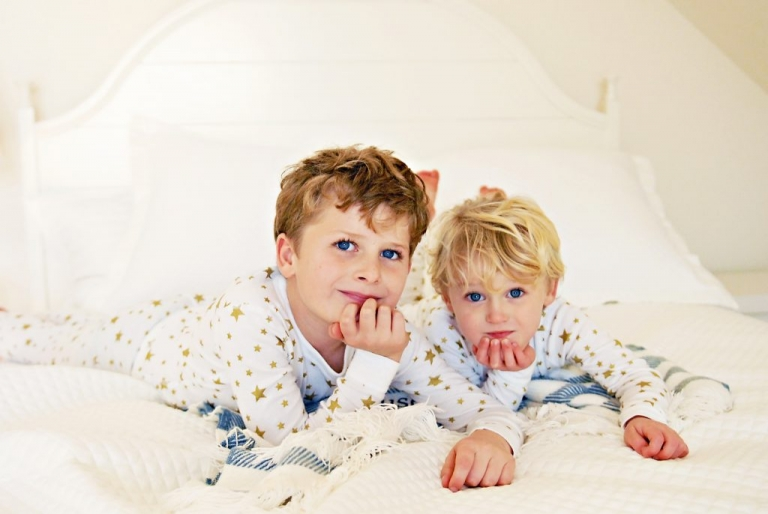 portrait of brothers on a bed in fairfield ct by greenwich family photographer daisy beatty