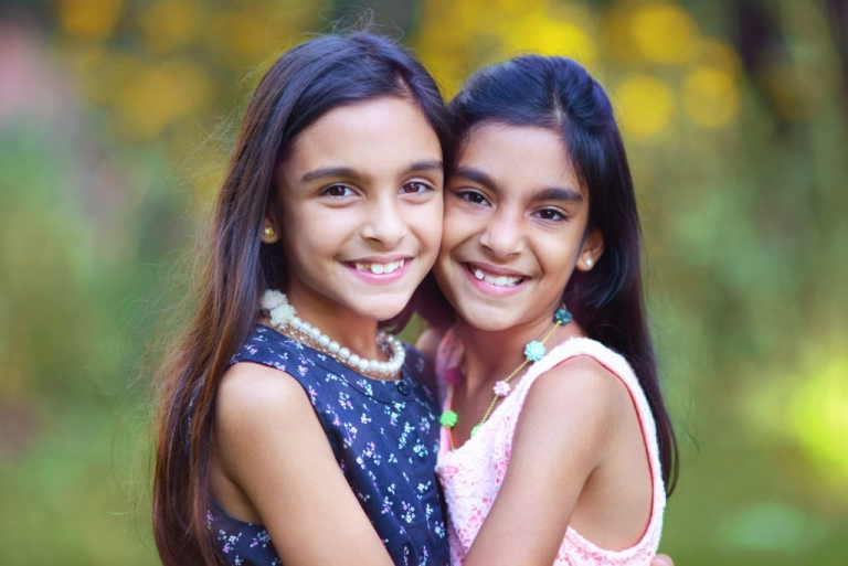 vibrant photographic portrait of sisters in greenwich ct by daisy beatty photography