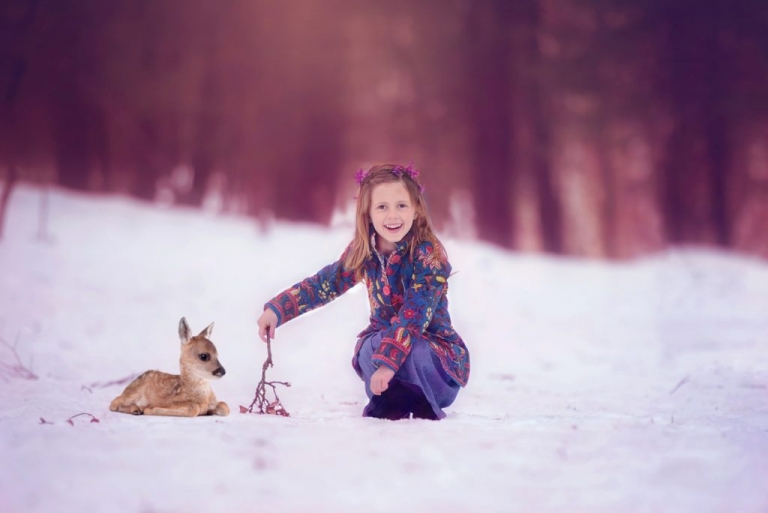 magical portrait of a girl and fawn in the woods of nyc by daisy beatty