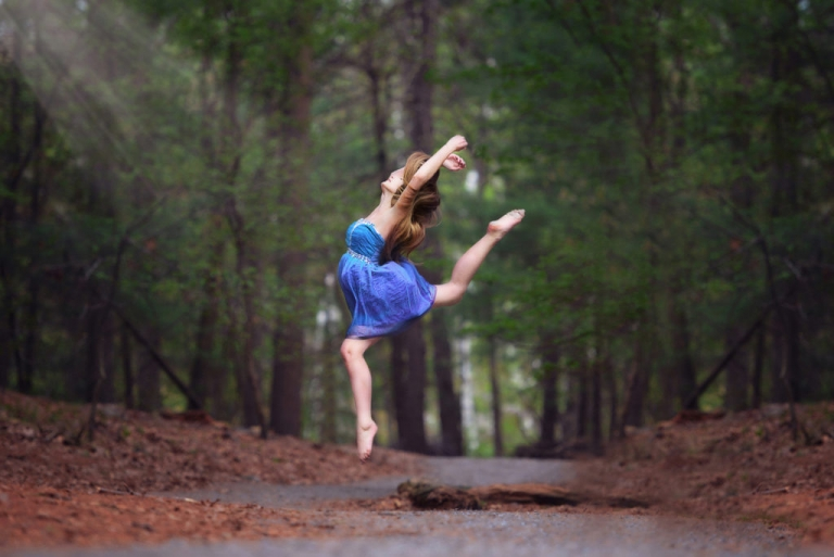 professional child portrait of a girl dancing in a park in nyc by daisy beatty photography