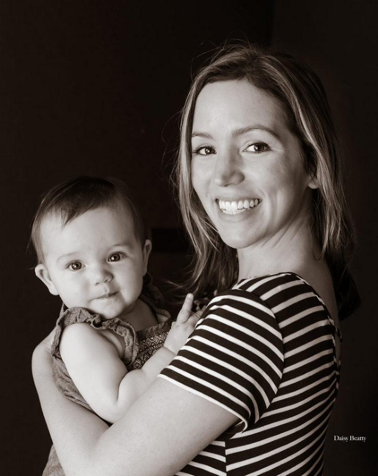 black and white studio portrait of a beautiful mother and her seven month old daughter in manhattan nyc