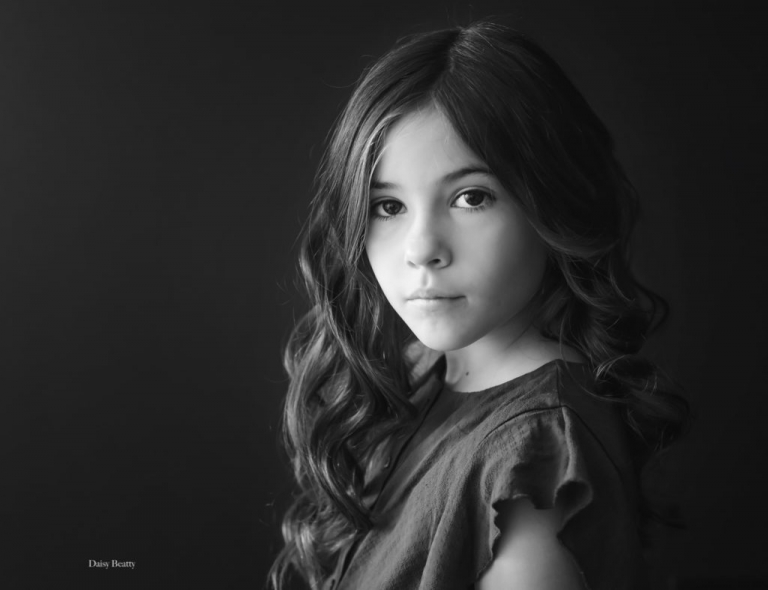 classic black and white child portrait in nyc of child model Isabella Kirk by Daisy Beatty photography