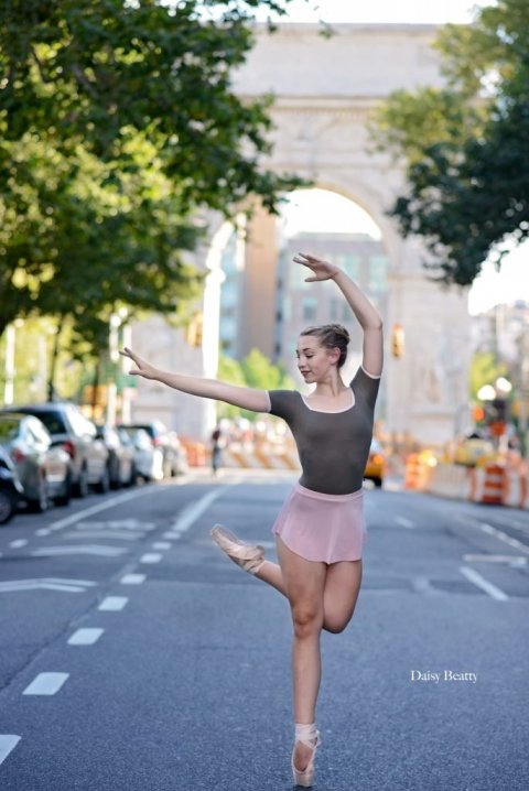 a ballet dancer on 5th avenue in front of the washington square arch in nyc by manhattan dance photographer daisy beatty