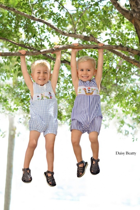portrait of toddler twins laughing in hoboken nj by manhattan family photographer daisy beatty