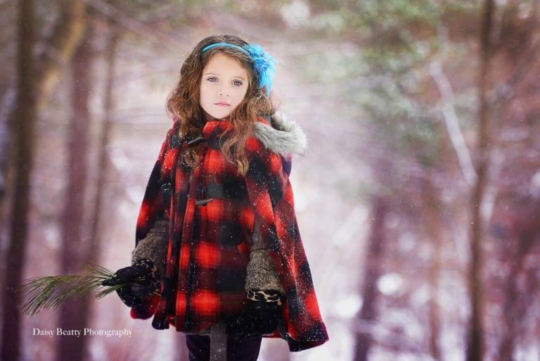 child portrait in the snow by boston family photographer daisy beatty