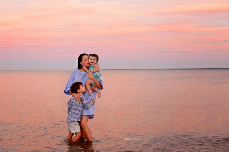portrait of a mother and two children at sunset in Tod's Point by Greenwich CT family photographer Daisy Beatty