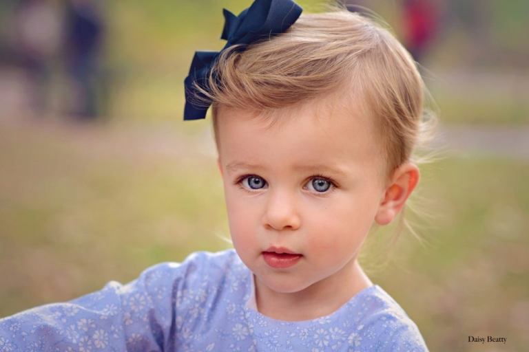 portrait of a young girl in central park by daisy beatty photography