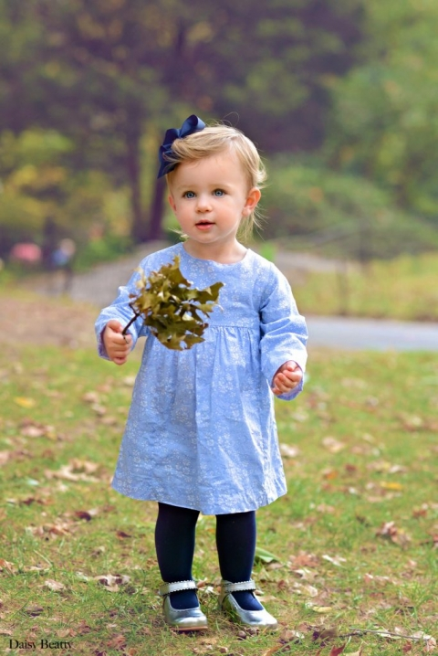 portrait of a girl with leaves in central park nyc