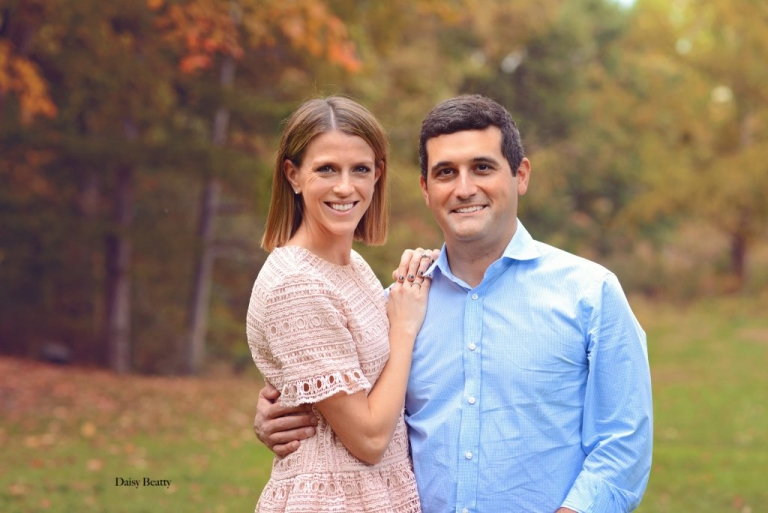 vibrant portrait of a couple in central park in autumn by daisy beatty