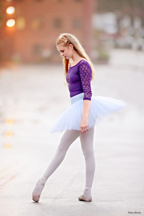 portrait of a ballet dancer in a parking lot in worcester MA by daisy beatty photography