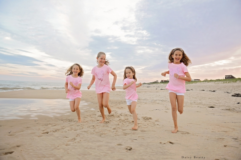 girls on the beach at sunset by new york city family photographer daisy beatty
