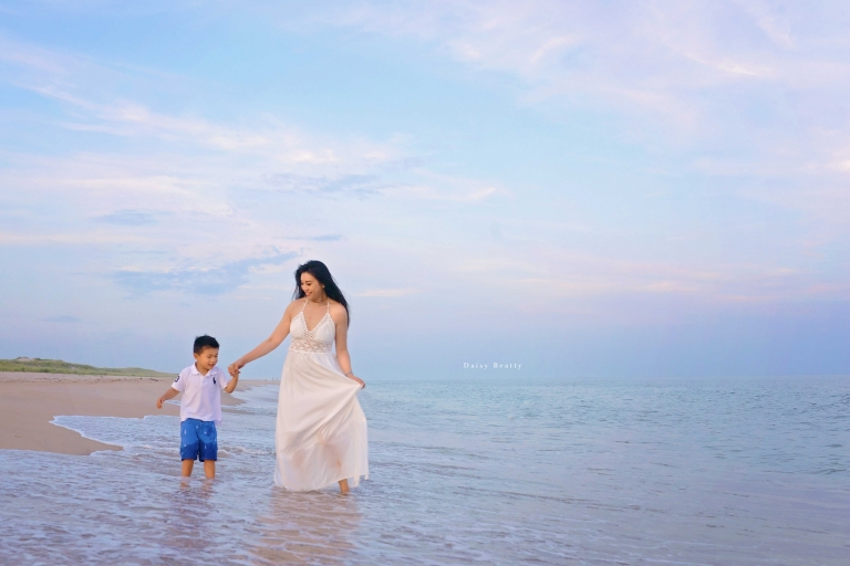 a sunset beach portrait of a mother and son by hamptons photographer daisy beatty
