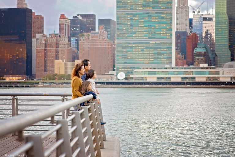 family photo session with nyc cityskape in the background