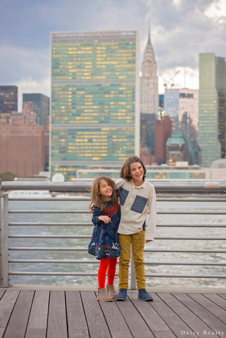 family vacation photos in nyc with skyline views of manhattan