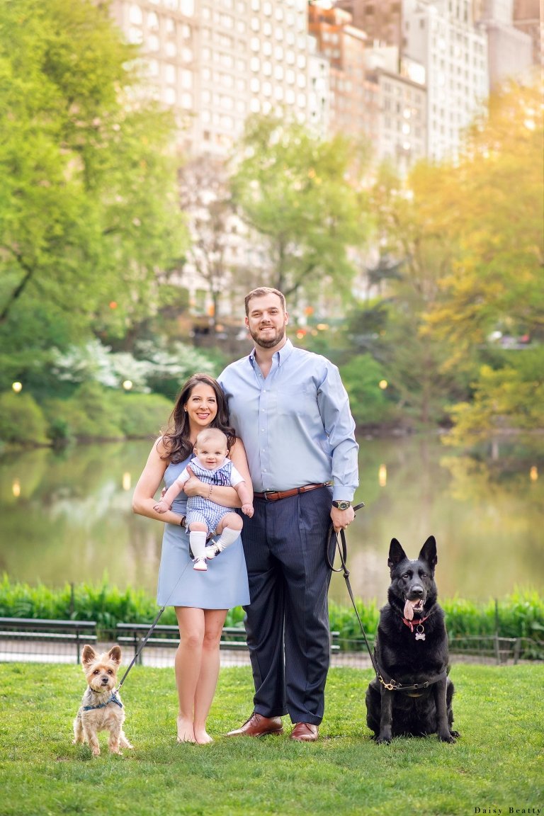 a family with two dogs in central park in april