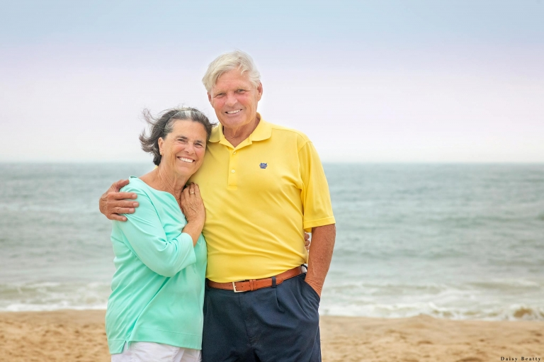 a couple at sunset on the beach of the bridgehampton club